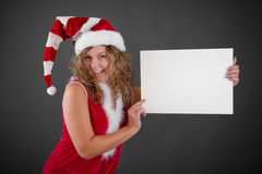 Happy woman in Santa hat holding blank sign Royalty Free Stock Photo