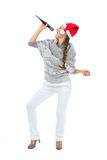 Happy woman in Santa hat singing in microphone Royalty Free Stock Photography