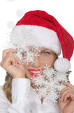 Happy woman in Santa hat with snowflakes Royalty Free Stock Photo
