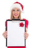 Happy woman in santa hat with wish list posing isolated on white Stock Photos