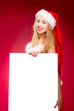 Happy woman in santa helper hat. With blank white board Stock Photography