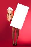 Happy woman in santa helper hat Stock Photography