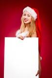 Happy woman in santa helper hat Stock Image