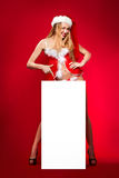 Happy woman in santa helper hat. With blank white board Royalty Free Stock Photos