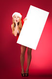 Happy woman in santa helper hat. With blank white board Royalty Free Stock Images
