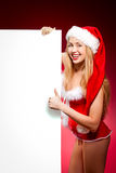 Happy woman in santa helper hat. With blank white board Royalty Free Stock Image