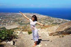 Happy woman on Santorini island Royalty Free Stock Photos