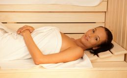 Happy woman in sauna Stock Photography