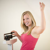 Happy woman on scale stock photo