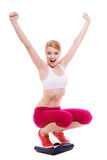 Happy woman on scale celebrating weightloss Royalty Free Stock Image