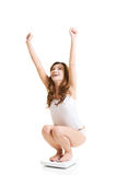 Happy woman on scale. Royalty Free Stock Image