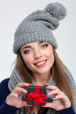 Happy woman with scarf and hat holding jewelry gift box Stock Image
