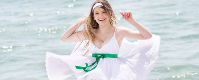 Happy woman on sea background Royalty Free Stock Photo