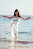 Happy  woman  on  sea  beach Royalty Free Stock Photo