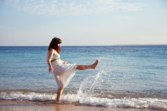 Happy  woman at sea  coast Royalty Free Stock Photography