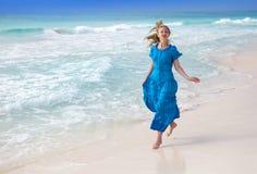 Happy woman on sea coast Royalty Free Stock Photography