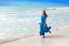 Happy woman on sea coast Stock Photo