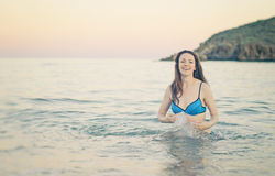 Happy woman in the sea splashing water. Royalty Free Stock Photos