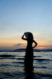 Happy Woman in Sea Sunset Stock Photography