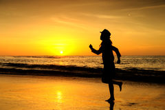 Happy Woman in Sea Sunset at krabi Thailand Stock Image