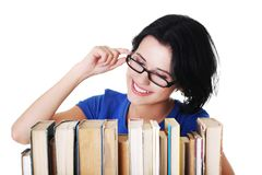 Happy woman searching for an interesting book Royalty Free Stock Photography