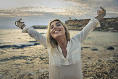 Happy woman at the seaside Stock Images