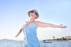 Happy woman at seaside Stock Image