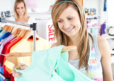 Happy woman selecting item Royalty Free Stock Photography