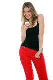 Happy woman sending a text message Stock Images