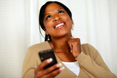 Happy woman sending a text message by the mobile Stock Photos