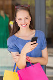 Happy woman sending a text message Stock Photo
