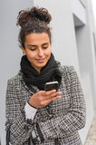 Happy woman sending text message on smartphone Royalty Free Stock Photo