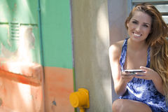 Happy woman sending text message Royalty Free Stock Photos