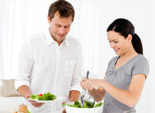 Happy woman serving salad to his boyfriend Stock Images