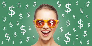 Happy woman in shades with dollar currency sings Royalty Free Stock Photos