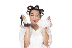Happy woman shoe shopping holding shoes in hands Royalty Free Stock Photography