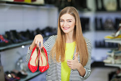 Happy woman in shoe store Stock Photo