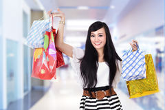 Happy woman with shooping bags Royalty Free Stock Image