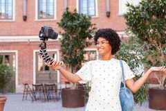Happy woman shooting video content royalty free stock photos