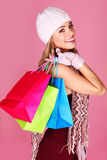 Happy Woman Shopper. Beautiful smiling woman carrying colourful carrier bags over her shoulder stock image
