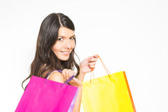 Happy woman shopper with colorful bags Stock Images