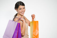 Happy woman shopper with colorful bags Stock Photo
