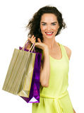 Happy woman shopping. Isolated portrait of a beautiful happy woman shopping and holding shopping bags stock image