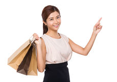Happy woman with shopping bag and finger up Stock Photos