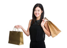 Happy woman with shopping bag Royalty Free Stock Photos