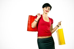 Happy woman with shopping bags. Isolated on white royalty free stock photo