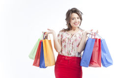 Happy woman with shopping bags. Happy young woman carrying colorful shopping bags, isolated on white background Stock Image