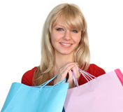 Happy Woman with shopping bags. Woman with shopping bags smiling at the camera Stock Image