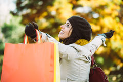 Happy woman with shopping bags in autumn Stock Image