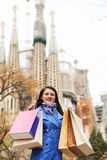Happy woman with shopping bags in Barcelona Stock Photos